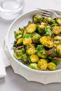 Baked Green Brussels Sprouts with honey and Parmesan cheese.