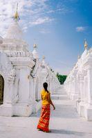 Tourist among of stupas in Kuthodaw Pagoda, known as the world's largest book. Kuthodaw is a Buddhist stupa, located in Mandalay, Burma Myanmar