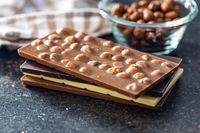 Various chocolate bars with hazelnuts.