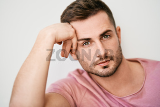 Closeup portrait of handsome sexy man looking at camera on white background