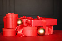 Red Christmas presents and golden baubles