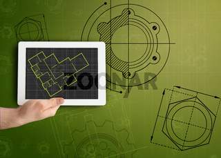 Tablet and plan on green background