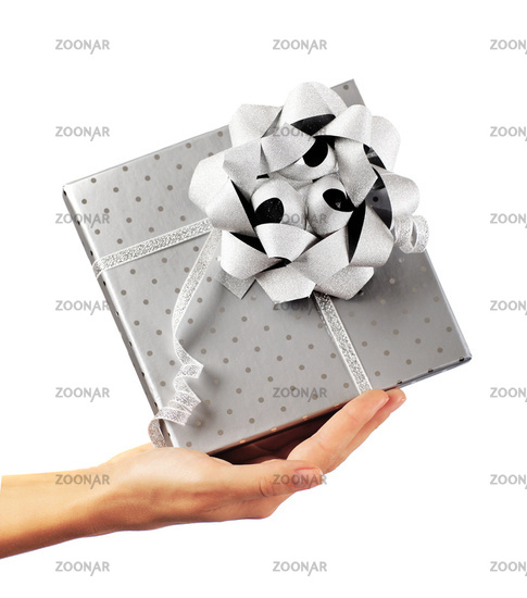 Female hand holding silver gift box