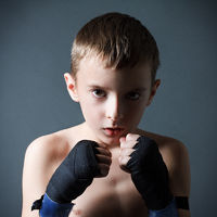 The boy the boxer trains blow in strap