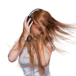 Woman with headphones and hair in motion on white