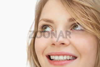 Woman looking up while smiling
