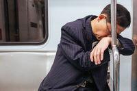 Tired Man on Subway in South Korea