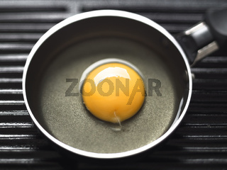 frying egg on a grill