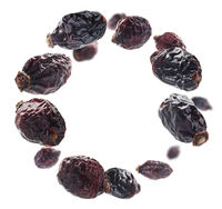 Dried rosehip berries levitate on a white background