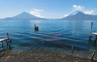 Tranquil view on lake Atitlan with view on volcano peaks in Santa Cruz la Laguna, Guatemala