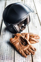 Safety motorcycle accessories. Leather gloves and helmet