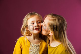 Mother and daughter in studio, happy moments