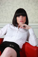 Smart businesswoman alone in armchair