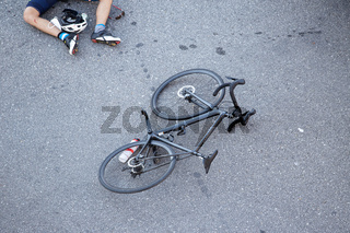 Bicycle accident on the road. Scene of a cyclist and bicycle on the asphalt after being hit by a vehicle