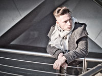One handsome young man in city setting in winter or autumn outfit