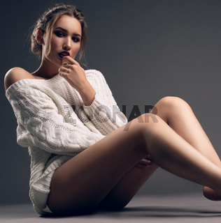 Gorgeous girl wearing only sexy pullover shot