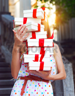 Gift boxes in the hands of young woman