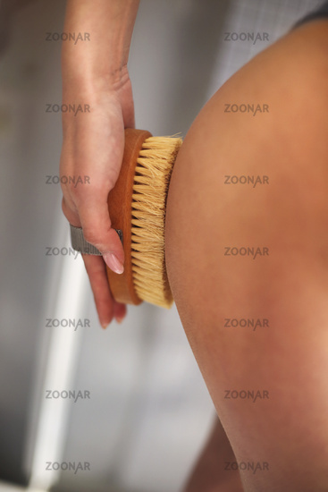 Young woman scrubbing her body
