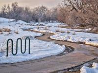 meandering bike trail in winter scenery