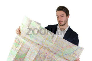 Young man looking at city map, confused or lost