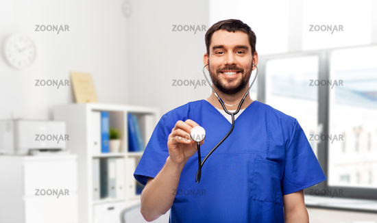 smiling male doctor or nurse with stethoscope