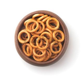 Wooden bowl of salty crispbread wheat mini rings