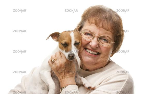 Happy Attractive Senior Woman with Puppy