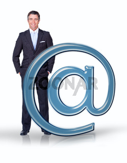 Businessman standing with email at symbol