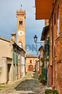 Old street with old bell tower in Santarcangelo di Romagna