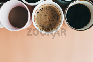 Multiple coffee cups on the beige background