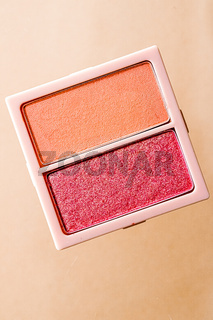Eyeshadow powder or blush makeup palette as flat lay isolated on golden background, beauty eye shadow as flatlay design, crushed make-up and cosmetic product