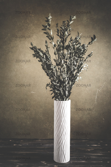 Bunch of eucalyptus branches  on wooden table in vintage style