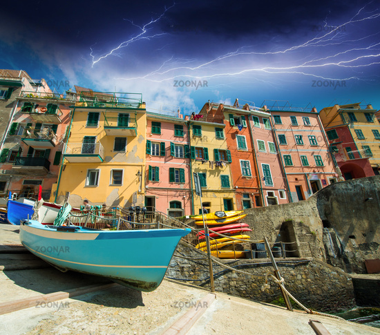 Cinque Terre. Beautiful view of the port with boats and colourful homes