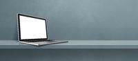 Laptop computer on grey shelf background banner
