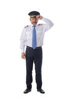 Confident pilot on white