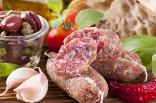 Salami with bread and vegetables
