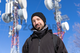 Person pose for picture at cellular base tower