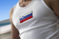 The national flag of Slovenia on the athlete's chest