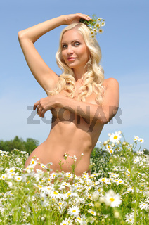 beautiful naked woman on the meadow