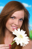 Beautiful cacuacsian woman with white flower