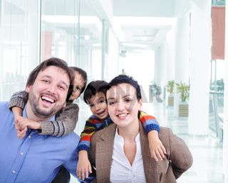 Young family with two children in the shopping mall