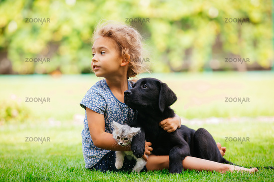 Pets giving their love to small children