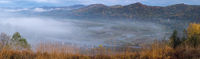 Morning fog on country foothills above Opir and Stryi rivers, and slopes of the Carpathian Mountains in far, Ukraine.