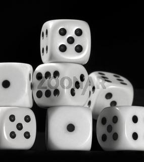 white dice in black back