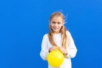 Young Girl Holding Party Balloon