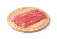 Bacon strips on cutting board