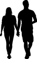 Silhouette of a young couple walking hand by hand