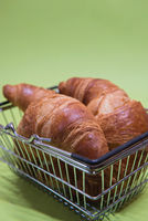 Macro shoot of croissants in shopping basket