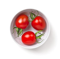 Three Cherry Tomatoes In White Bowl Isolated