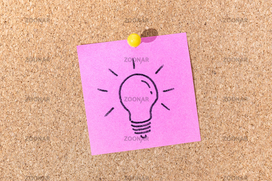 Bright Idea or Creative process concept. Light bulb drawing on sticky note on cork board